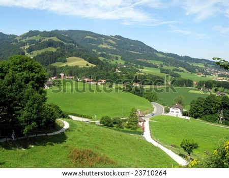 Gruyere region of Switzerland in summer. View from the village having  the same name