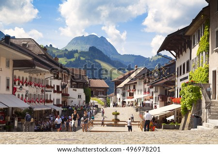 GRUYERES, CH, CIRCA JULY, 2016: View of the main street in the swiss town Gruyeres (Switzerland) on a beautiful summer day. Gruyere  gives its name to the well-known Gruyere cheese
