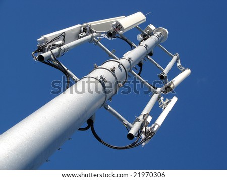 GSM Antenna against blue sky - stock photo
