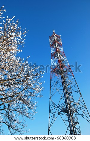 GSM tower covered by snow. - stock photo
