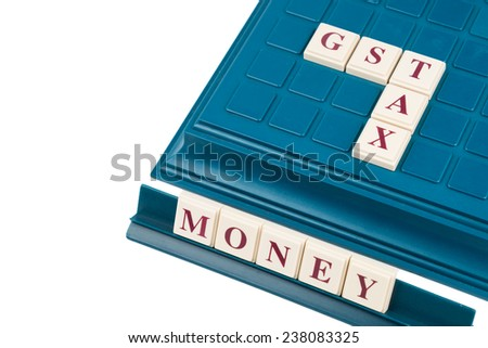 GST TAX concept on a cross word board game
