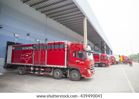 Gu'an, China - June 14, 2016: JD.com trucks receiving incoming goods and preparing shipments at the Northeast China based Gu'an warehouse and distribution facility, Gu'an, China