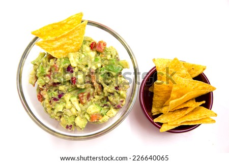 Guacamole and nachos on a white background seen from above - stock photo