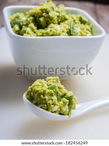 Guacamole Appetizer Healthy Snack in White spoon  - stock photo