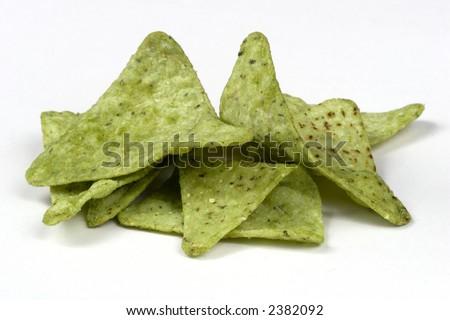 Guacamole flavored tortilla chips - stock photo