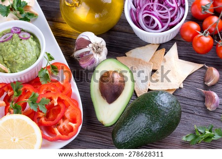 ... Bowl with mexican Tortilla Chips nachos and Ingredients - stock photo