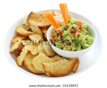 Guacamole served with bagel crisps and carrot sticks.  A healthy version of this traditional avocado dip. - stock photo