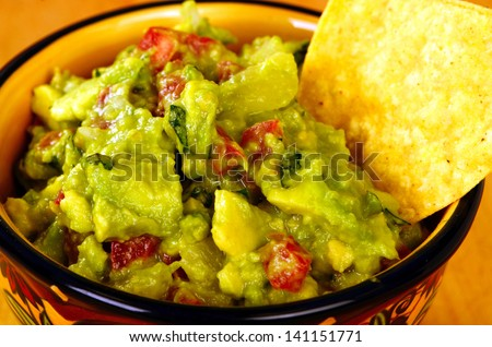 Guacamole with chips table top food shot - stock photo