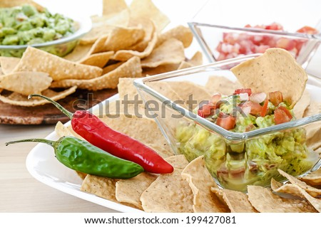 Guacamole with corn tortilla chips and chili