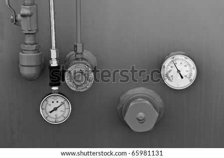 Guages On A Gas Storage Tank - stock photo