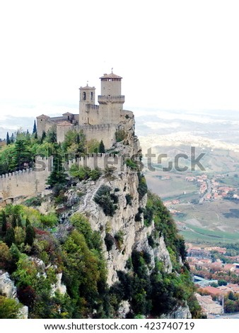 Guaita tower in the fortifications of San Marino on Monte Titano, with the cliff falling off below
