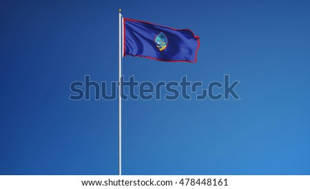 Guam flag waving against clean blue sky, long shot, isolated with clipping path mask alpha channel transparency