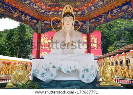 Guan Yin statue at Ten Thousand Buddhas Monastery in Hong Kong, China. - stock photo
