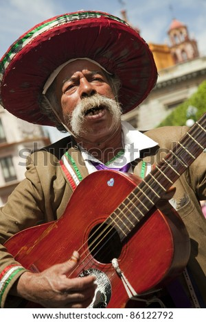 GUANAJUATO,MEXICO-MARCH 14:Unidentified Mexican guitarist plays on the streets of the Guanajuato city on March 14, 2010. Guanajuato is a picturesque and historic city, is located in central Mexico. - stock photo
