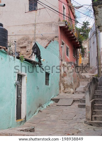 GUANAJUATO, MEXICO - OCTOBER 26, 2013: World Heritage Site (1988). Historic mine city has a lot of colorful 16th century buildings and narrow stone paved streets. About 170,000 population.