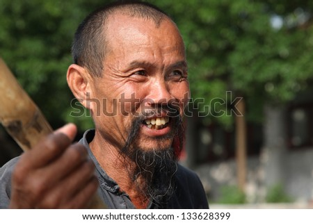 GUANGXI - JUNE 18: Chinese man in Guangxi region, traditional type of man face in China, June 18, 2012 in Guangxi, China. The average life expectancy among Chinese men is 72 years