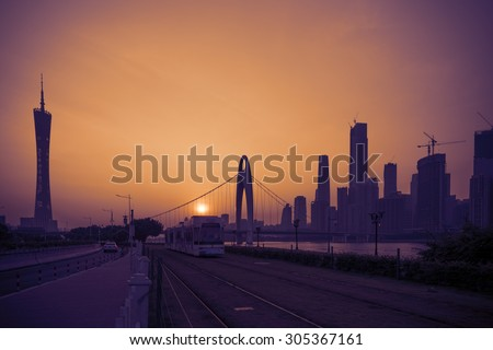 GUANGZHOU, CHINA - AUG 09, 2015: Sightseeing train moves on the rail along the Pearl River in Guangzhou city, Guangdong province, China - stock photo