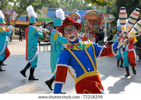 GUANGZHOU, CHINA - DEC 26: An unidentified clown performs in the christmas celebration of Changlong theme park on December 26, 2010 in Guangzhou city,China