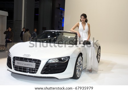 GUANGZHOU, CHINA - DEC 27: Fashion Model on Audi R8 car at the 8th China international automobile exhibition on December 27, 2010 in Guangzhou China.