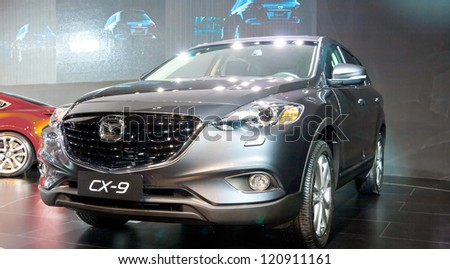 GUANGZHOU, CHINA - DEC 1:MAZDA cx-9 car on display at the 10th China(Guangzhou) International Automobile Exhibition. on Dec 1, 2012 in Guangzhou China. - stock photo