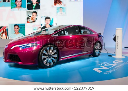 GUANGZHOU, CHINA - DEC 1:Toyota ns4 plug-in hybrid on display at the 10th China(Guangzhou) International Automobile Exhibition. on Dec 1, 2012 in Guangzhou China. - stock photo