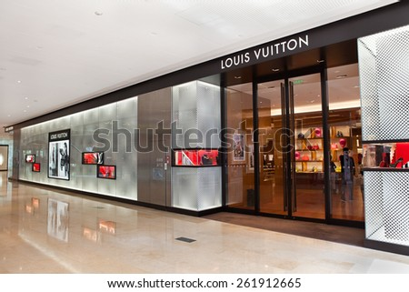 GUANGZHOU, CHINA - FEBRUARY 24, 2015: Louis Vuitton store; Louis Vuitton, a French fashion house founded in 1854, operates more than 460 stores worldwide. In 2013, brand had sales of 9.4 billion USD. - stock photo