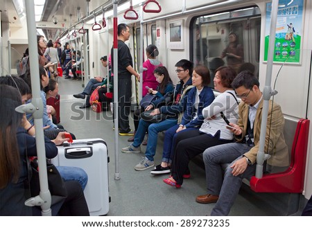 GUANGZHOU, CHINA - FEBRUARY 23, 2015: Unidentified people are seen at metro train. Guangzhouâ??s 9 Metro lines carry over six million passengers on an average day in 2014. - stock photo