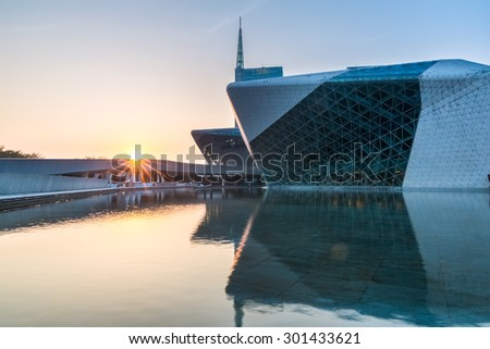 GUANGZHOU, CHINA - July 30: Guangzhou Opera House sunset landscape on July 30, 2015 in Guangzhou, China. Designed by architect Zaha Hadid and has become one of landmark building of guangzhou new axis - stock photo