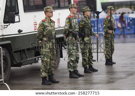GUANGZHOU, CHINA - MARCH 6. 2015:Armed paramilitary policemen stand guard in front of the Guangzhou Railway Station after a knife attack, in Guangzhou, Guangdong province.