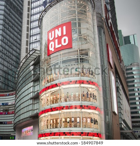 Guangzhou, China - March 30,2014: New Uniqlo store open for business at Guangzhou. Uniqlo is a Japanese casual wear designer, manufacturer and retailer - stock photo