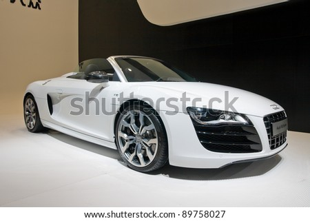 GUANGZHOU, CHINA - NOV 25: AUDI R8 white sport car on display at the 9th China(Guangzhou) International Automobile Exhibition. on November 25, 2011 in Guangzhou China. - stock photo