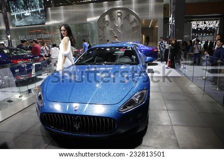 GUANGZHOU, CHINA - NOV. 22. 2014: Maserati stand during the 12th China International Automobile Exhibition in Guangzhou, Guangdong province. - stock photo