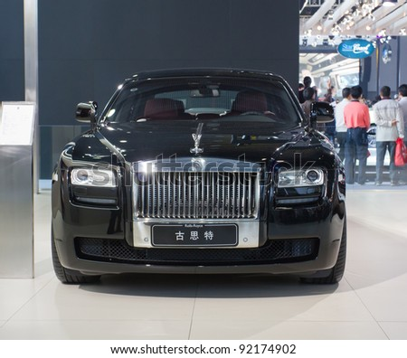 GUANGZHOU, CHINA - NOV 26: Rolls-Royce Ghost car on display at the 9th China international automobile exhibition on November 26, 2011 in Guangzhou China. - stock photo