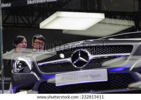 GUANGZHOU, CHINA - NOV. 20. 2014: Spectators looking Mercedes SL 350 car on the 12th China International Automobile Exhibition in Guangzhou, Guangdong province. - stock photo