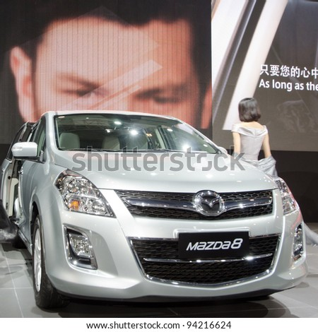 GUANGZHOU, CHINA - NOV 26: unidentified model with Mazda 8 car at the 9th China international automobile exhibition. on November 26, 2011 in Guangzhou China.