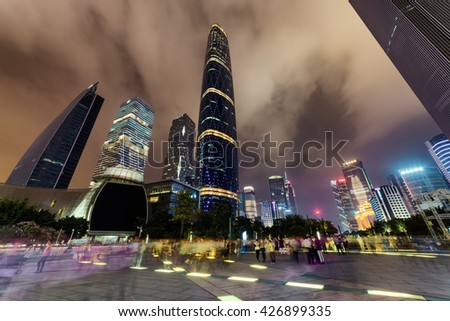 GUANGZHOU, CHINA - NOVEMBER 7, 2015: Amazing night view of skyscrapers and other modern buildings at the Zhujiang New Town. Bottom view of the Guangzhou International Finance Centre on sky background. - stock photo