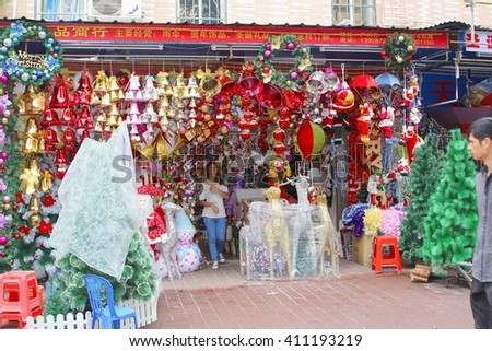 GUANGZHOU, CHINA - November 10. Shopkeeper sells Christmas decorations and Christmas articles in a Christmas shop on November 10, 2013 in Guangzhou.  - stock photo