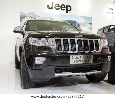 gUANGZHOU, CHINA - OCT 02: Jeep Grand Cherokee car on display at the Guangzhou daily Baiyun international automobile exhibition. on October 02, 2011 in Guangzhou China. - stock photo