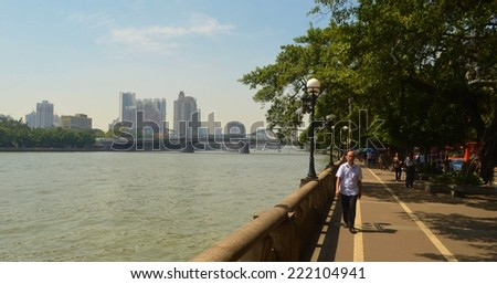 GUANGZHOU, CHINA, OCTOBER 2, 2013: People are strolling on riverside of pearl river in guangzhou, china.