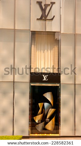 GUANGZHOU,CHINA - SEP 29: Louis Vuitton shop on Sep 29, 2014 in Guangzhou. Forbes claims Louis Vuitton was the most powerful luxury brand in the world in 2008 with $19.4bn USD value. - stock photo