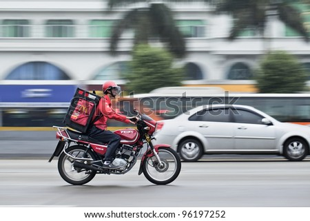 GUANGZHOU - FEB. 22: McDonald delivery motorcycle on Feb. 22, 2012 in Guangzhou. It took McDonald 19 years to reach 1,000 restaurants in China and the company plans to double the number to 2,000 by 2013. - stock photo