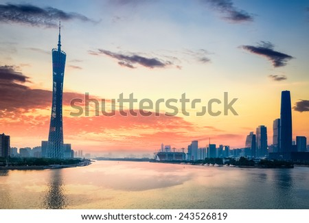 guangzhou in sunset,  city skyline on the pearl river. - stock photo