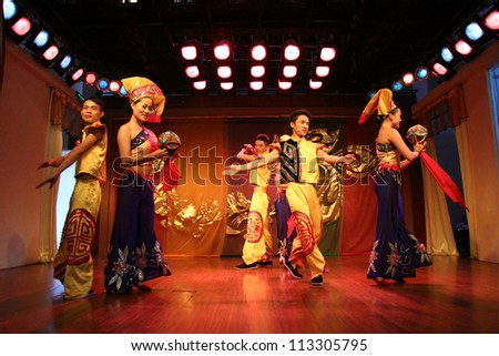 GUANGZI, CHINA - SEPTEMBER 18 : Unidentified minority dancers with traditional clothes perform local dance called Welcome Home show on stage on September 18, 2011 in Guangzi Zhuang Autonomous Region, China.