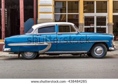 Guantanamo, Cuba - June 6, 2014: Blue Chevrolet parked in the streets of Guantanamo city.