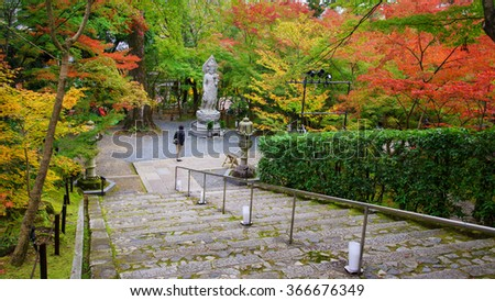 Guanyin statue and autumn garden at Eikando temple in Kyoto, Japan