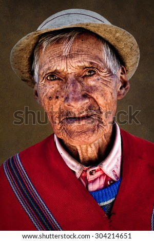GUARANDA, BOLIVAR, ECUADOR - JANUARY 19, 2013 : Portrait of old indigenous man from Guaranda Ecuador wearing traditional clothing - stock photo