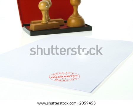 Guarantee Rubber stamps - stock photo