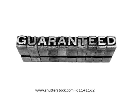 GUARANTEED written in metallic letters on a white background - stock photo