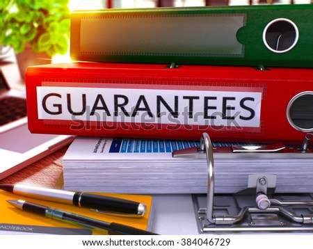 Guarantees - Red Ring Binder on Office Desktop with Office Supplies and Modern Laptop. Guarantees Business Concept on Blurred Background. Guarantees - Toned Illustration. 3D Render. - stock photo