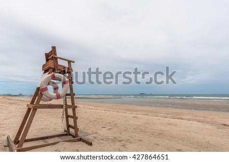 Guard chair on the beach to watch and rescue tourism - stock photo
